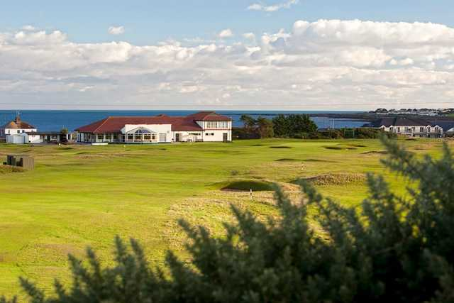A view of the clubhouse and two greens at Kirkistown Castle Golf Club.