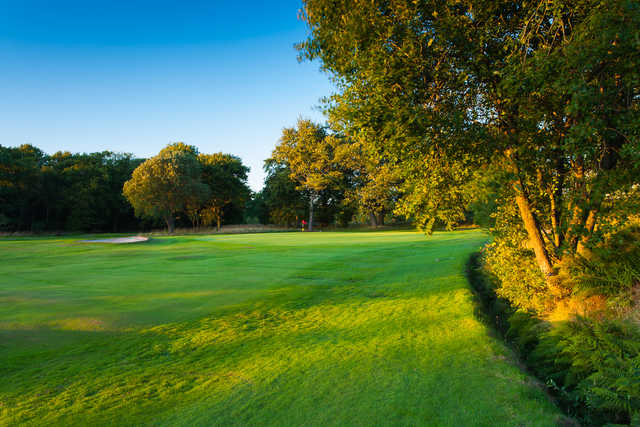 A sunny day view of a hole at Bishopbriggs Golf Club.