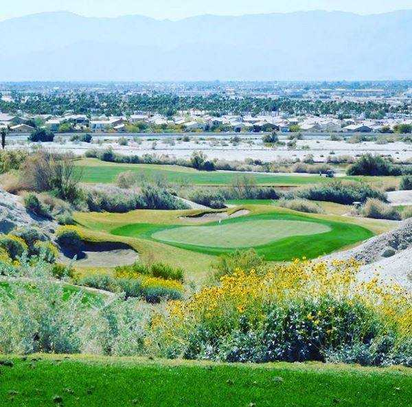 A view of a green at South Course from Golf Club At Terra Lago.