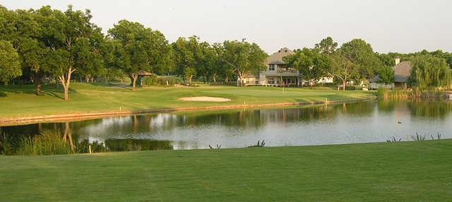 A sunny day view of a hole at Pecan Plantation Country Club.