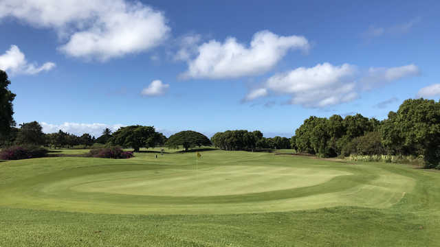 A sunny day view of a green at Kiahuna Golf Club.