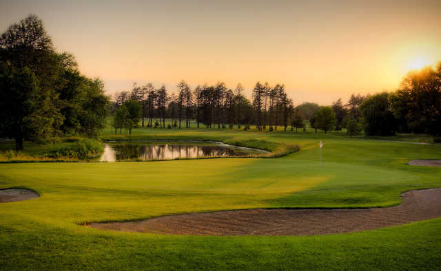 A sunset view of a hole at Pine Meadow Golf Club.