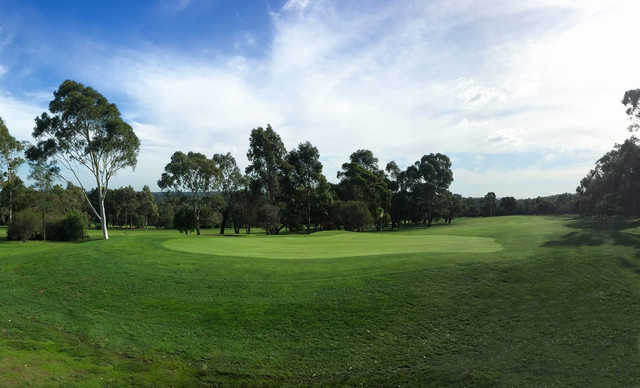A sunny day view of a green at Waverley Golf Club.