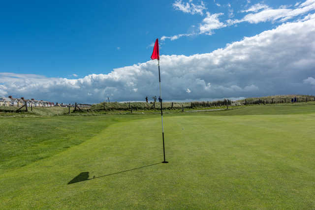 A sunny day view of a hole at Bude & North Cornwall Golf Club.