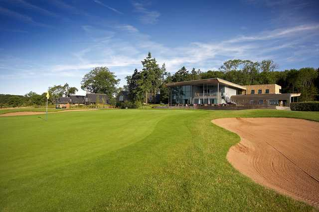View of the 18th green and clubhouse at KP Club