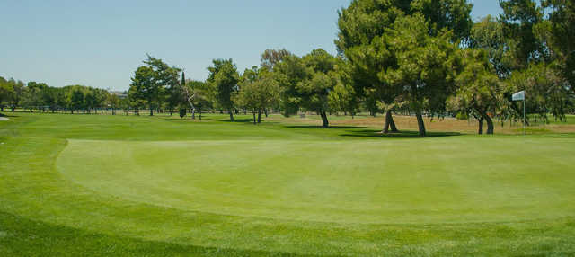 A sunny day view of a hole at Diablo Creek Golf Course.