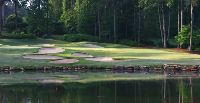A view of a green surrounded by a collection of tricky bunkers at St. Marlo Country Club.