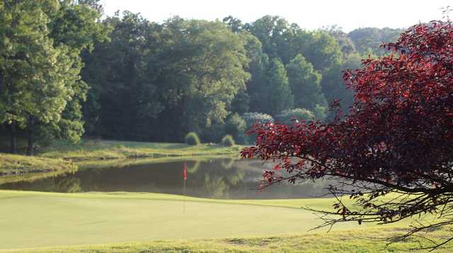 A view of a green with water coming into play at Woodland Hills Golf and Country Club.