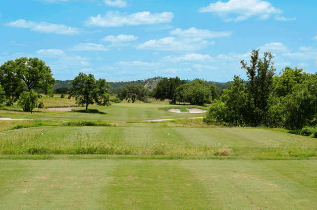 A view of the 3rd green at Creeks Course from The Club At Comanche Trace.