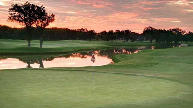 A sunset view of a hole at Sky Creek Ranch Golf Club.