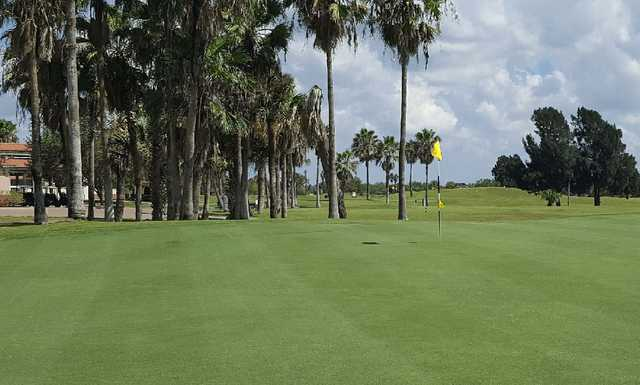 A sunny day view of a hole at Brownsville Golf Center.