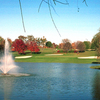 A view of a hole protected by bunkers with a water fountain in foreground at Beckett Ridge Country Club