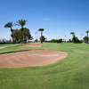A view of a fairway with bunkers on the left side at Palmbrook Country Club
