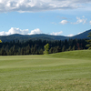 A view of a hole with wooded mountains in background at Links Golf Club