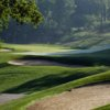 A view of a green guarded by bunkers at The Fort Golf Resort.