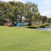 A view of green with clubhouse in background at Redland Bay Golf Club