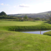 A view of a hole with water on the right side at Vale of Leven Golf Club