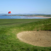 A view of a green with water in background at Bundoran Golf Club