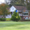 A view of the clubhouse with green in foreground at Beech Park Golf Club