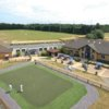 A view of the clubhouse and driving range at Downshire Golf Complex