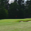 A view of green guarded by bunkers at Farnham Park Course from South Buckinghamshire