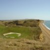 A view of green surrounded by bunkers at Bridport and West Dorset Golf Club