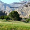 A view of a tee with mountains in background at Kern Valley Golf Course.