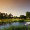 A view over the pond of green #11 at New Course from Burhill Golf Club