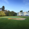 A view of the 18th green with the clubhouse in background at New Course from Burhill Golf Club