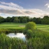 A view of green #11 protected by the pond and sand traps at The Stratford Park Hotel & Golf Club