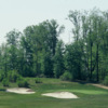 A view of green #1 guarded by tricky bunkers at Cherry Wood Golf Course