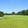 A view of a green protected by bunker at Stonebridge Golf Course