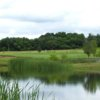 A view over the water of green #8 at Oeste Ranch Golf Course