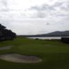 A view of a green with water in background at Greenore Golf Club