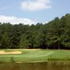 A view over the water of hole #15 at Cotton Fields Golf Club