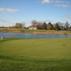 A view of a hole with water in background at Stone Ridge Golf Club