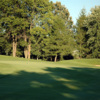 A view of a green protected by a bunker at Reedsburg Country Club