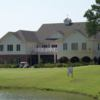 A view of the practice putting green and clubhouse from The Links at Cadron Valley Golf & Country Club