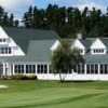 A view of a green and the clubhouse in background at Charlevoix Golf & Country Club