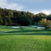 A view of a green flanked by bunkers Honey Run Golf & Country Club
