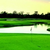 A view of a green with water in background at Heatherwoode Golf Club