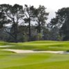 A view of a green protected by bunkers at Monterey Pines Golf Club