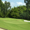 View of a green and bunker at Charlie Yates Golf Course