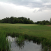 View over the pond of the 7th green at Waterfront Golf Club