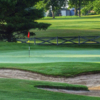 A view of a green protected by a bunker at Carlisle Golf and Country Club