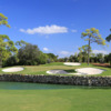 A view of a hole surrounded by tricky bunkers at Adios Golf Club
