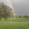 A view of the 2nd hole with rainbow in backgroun at Greenhorn Creek Golf Course