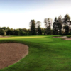 A view of the 12th hole guarded by sand traps at Pine Meadow Golf Club