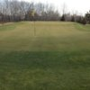 A view of a green protected by bunkers at Pine Ridge Golf Course