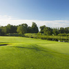 A view of a green with water in background at Luttrellstown Castle Golf and Country Club